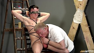 Old man sucks twink's dick during their BDSM gay play