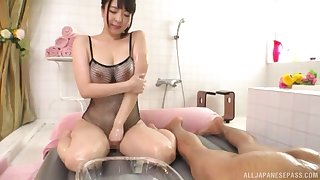 Oiled up Japanes at hand fishnets Mashiro An cums while riding bushwa